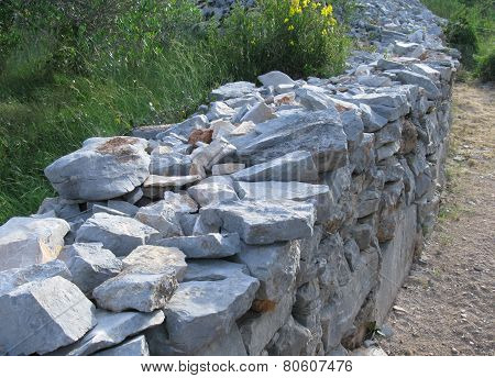 Dry stone wall along a trail