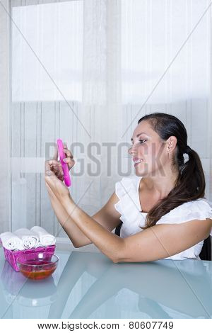 Woman Filing Nails.