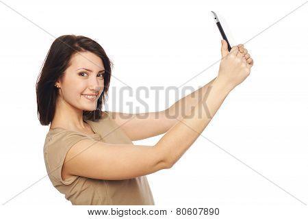 Female taking selfie with digital tablet
