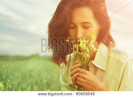 Woman Smelling Flowers In Summer