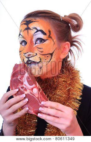 Girl tiger with the piece of raw meat.