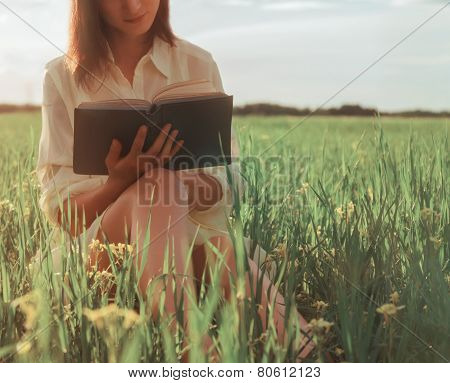 Woman Reading A Book In Summer