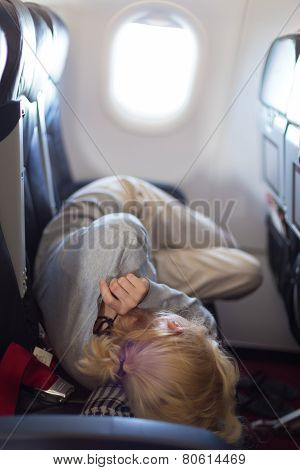 Young woman sleeping on airplane