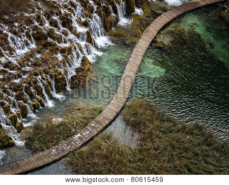 Diagonal Wooden Catwalk By Waterfalls