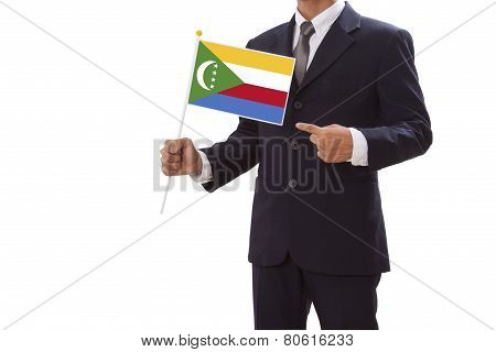 Businessman in suit holding a business card with Comoros Flag