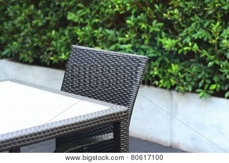 Brown Chairs In A Garden At The Park