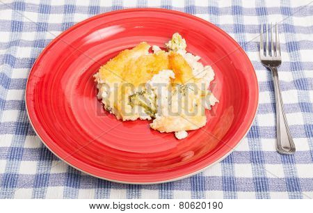 Cheesy Chicken And Broccoli Casserole On Red Plate