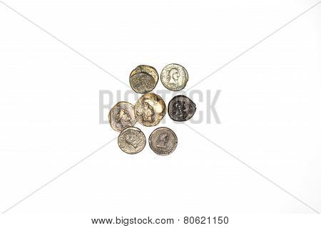 A Few Antique Coins On White Background