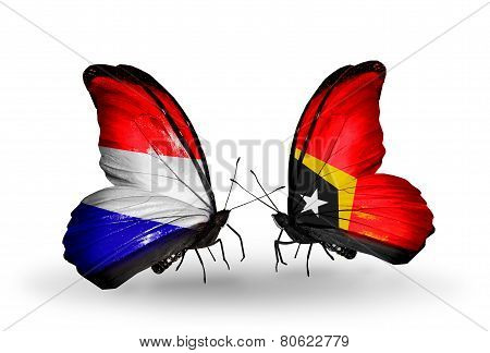 Two Butterflies With Flags On Wings As Symbol Of Relations Holland And East Timor