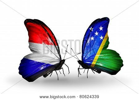 Two Butterflies With Flags On Wings As Symbol Of Relations Holland And Solomon Islands