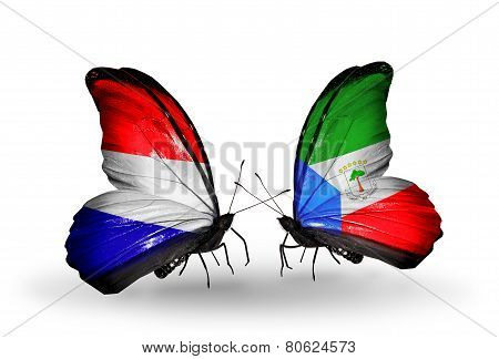 Two Butterflies With Flags On Wings As Symbol Of Relations Holland And Equatorial Guinea