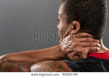 Young handsome African basketball player feeling pain