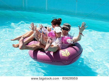 Family floating on an inflatable raft