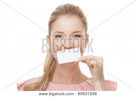 Beautiful woman with perfect skin and face holding empty blank card in hand.  Isolated.