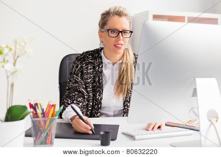 Female designer working with computer
