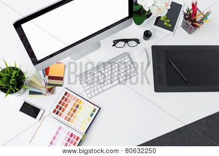 Creative professional designer's desk from above
