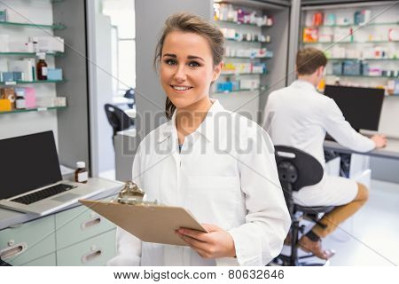 Pharmacy intern smiling at camera at the hospital pharmacy