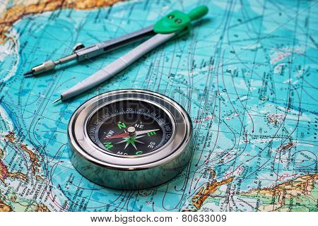outdated compass sailor on topographic map