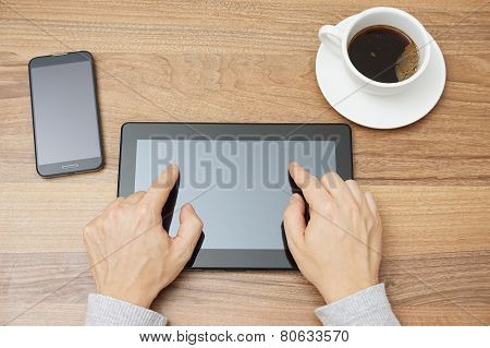 Young Adult Is Typing With Two Fingers On Tablet Computer, Top View