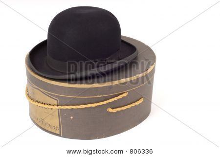 Old derby hat resting on hatbox