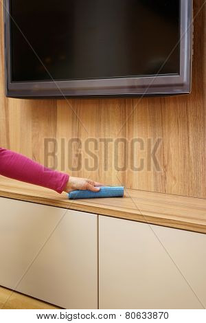 Housemaid Is Removing Dust From Furniture