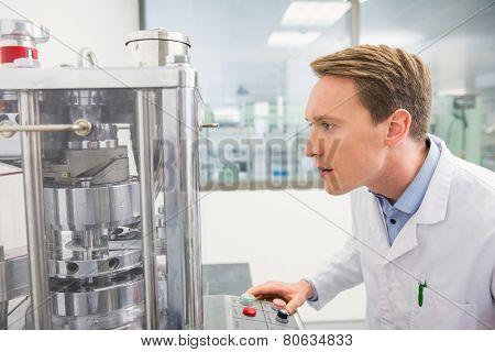 Focused pharmacist using advanced technology at the hospital pharmacy
