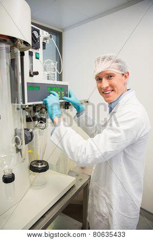 Pharmacist using machinery to make medicine at the laboratory