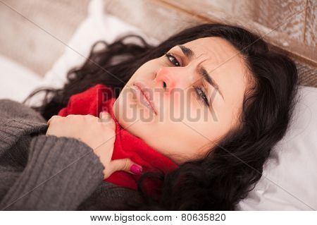 Young sick girl lying in bed