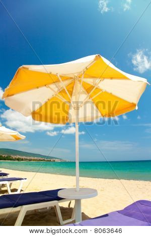 Bright Umbrellas And Chairs