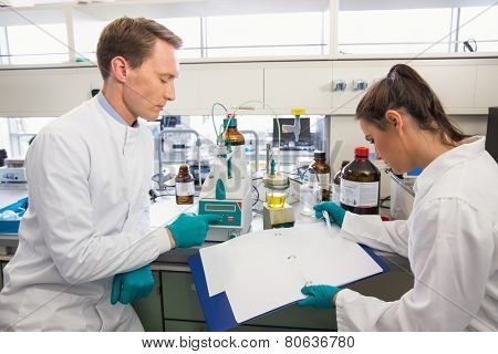 Young scientists conducting an experiment together at the laboratory