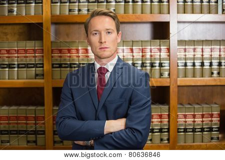 Lawyer frowning in the law library at the university