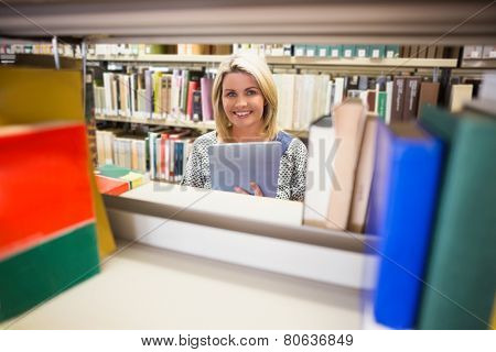 Mature student smiling in library at the university