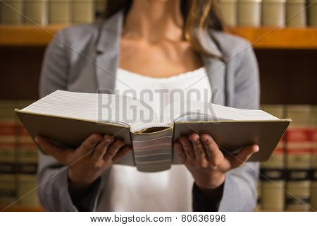 Lawyer reading in the law library at the university