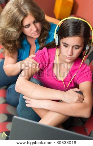 Teenage problems - Worried mother tries to comfort her sad teenage girl