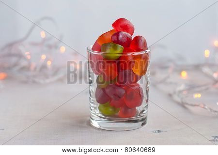 Jellies In A Glass On Table With Garland Lights. Selective Focus