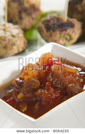 Chutney With Meatballs In Background