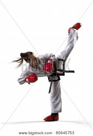 Professional female karate fighter isolated on white