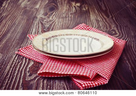 Vintage Plate On Red Kitchen Towel