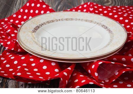 Vintage Plate On Red Kitchen Towel