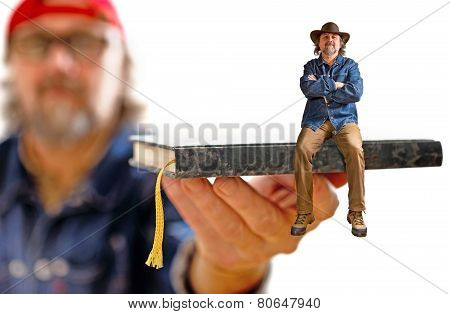 Man With Hat Sitting On The Book