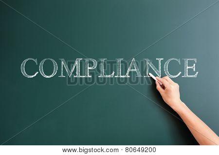 compliance written on blackboard