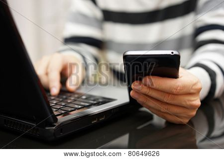 Teenager Addicted To The Internet And Social Media Using Phone And Laptop At The Same Time