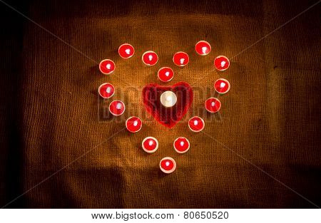 Red Candles Forming Heart Shape On Linen Cloth