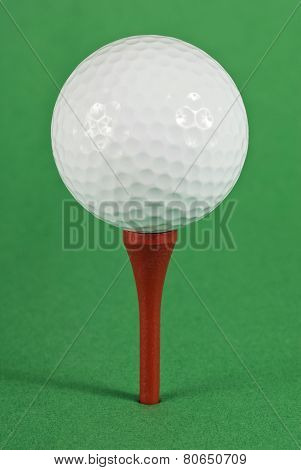 Golf Ball On Red Tee And Green Background