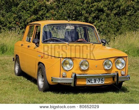 Yellow Renault 8S Car Parked On Grass