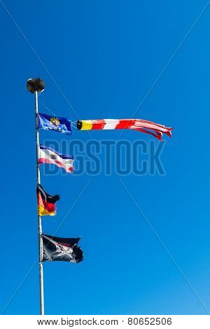 Flagpole And Blue Sky