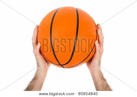 Two Hands Holding A Basketball Over White
