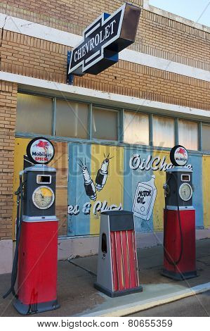 A Street Scene Of Vintage Signs And Gas Pumps, Lowell, Arizona