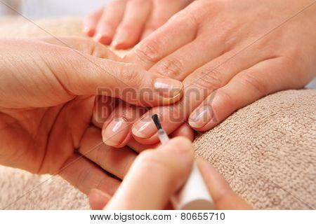 Nail Polish woman to a beautician