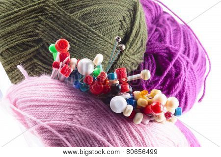 Variety Of Different Knitting Needles With Wool
